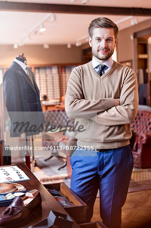 Portrait confident tailor in menswear shop Stock Photo - Premium Royalty-Free, Image code: 6113-08722355