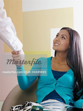 Doctor greeting patient Stock Photo - Premium Royalty-Free, Image code: 6114-06589889