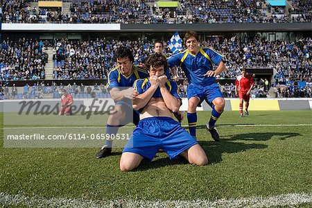 Footballers celebrating Stock Photo - Premium Royalty-Free, Image code: 6114-06590531