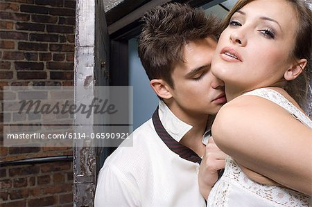 A man kissing a woman on the neck Stock Photo - Premium Royalty-Free, Image code: 6114-06590921