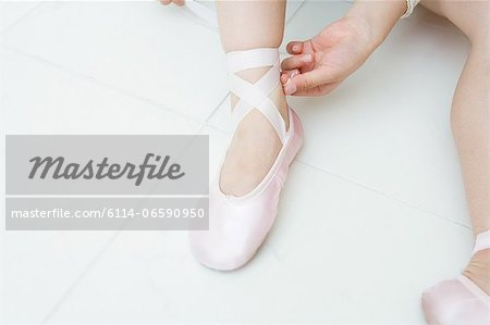 Putting on ballet slippers Stock Photo - Premium Royalty-Free, Image code: 6114-06590950