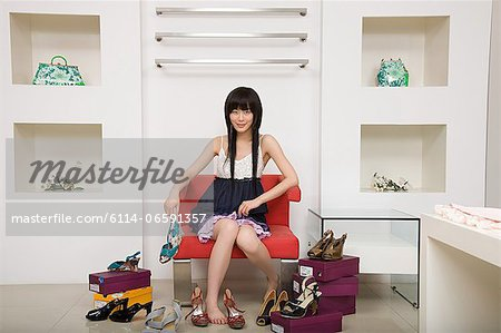 Woman shopping for shoes Stock Photo - Premium Royalty-Free, Image code: 6114-06591357