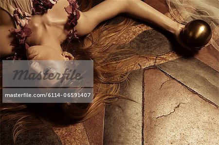 Young woman lying on floor Stock Photo - Premium Royalty-Free, Image code: 6114-06591407