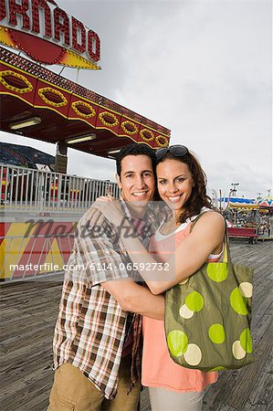 Couple at amusement park Stock Photo - Premium Royalty-Free, Image code: 6114-06592732