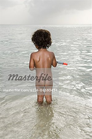 Nude boy in the sea Stock Photo - Premium Royalty-Free, Image code: 6114-06593494