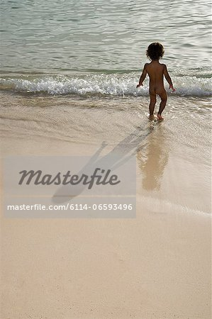 Nude boy in the sea Stock Photo - Premium Royalty-Free, Image code: 6114-06593496