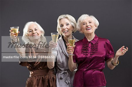 Senior female friends toasting with champagne Stock Photo - Premium Royalty-Free, Image code: 6114-06596650