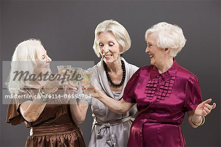 Senior female friends toasting with champagne Stock Photo - Premium Royalty-Free, Image code: 6114-06596704