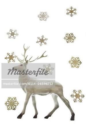 Reindeer figurine and snowflakes Stock Photo - Premium Royalty-Free, Image code: 6114-06596712