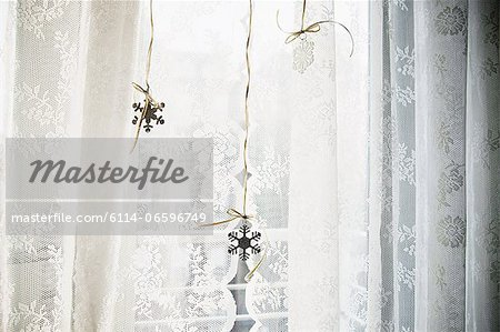 Snowflake decorations in window Stock Photo - Premium Royalty-Free, Image code: 6114-06596749