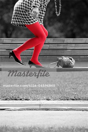 Woman on bench with red tights Stock Photo - Premium Royalty-Free, Image code: 6114-06596840