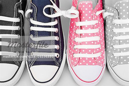 Blue and pink sneakers Stock Photo - Premium Royalty-Free, Image code: 6114-06596880