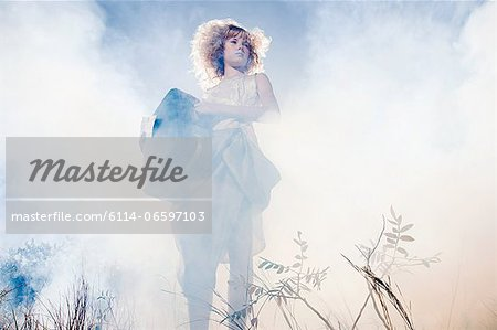 Girl with a suitcase Stock Photo - Premium Royalty-Free, Image code: 6114-06597103