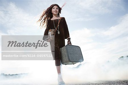 Girl with a suitcase Stock Photo - Premium Royalty-Free, Image code: 6114-06597112