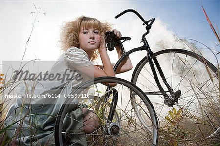 Girl with a bicycle Stock Photo - Premium Royalty-Free, Image code: 6114-06597116