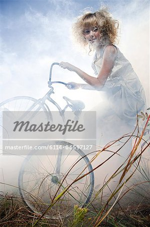 Girl with a bicycle Stock Photo - Premium Royalty-Free, Image code: 6114-06597127