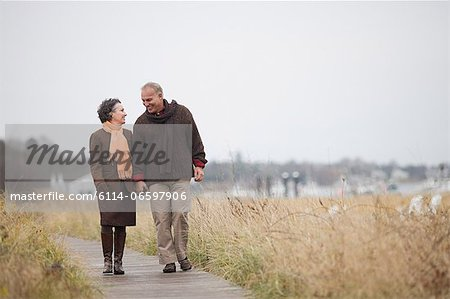 Mature couple walking Stock Photo - Premium Royalty-Free, Image code: 6114-06597906