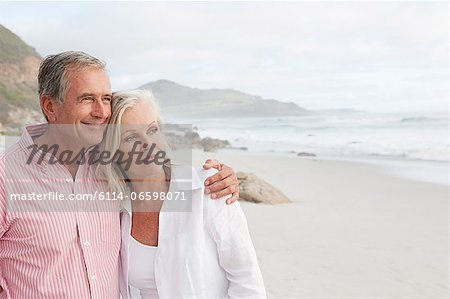 Mature couple at the beach Stock Photo - Premium Royalty-Free, Image code: 6114-06598071