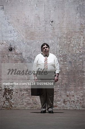 Man standing in warehouse Stock Photo - Premium Royalty-Free, Image code: 6114-06598264
