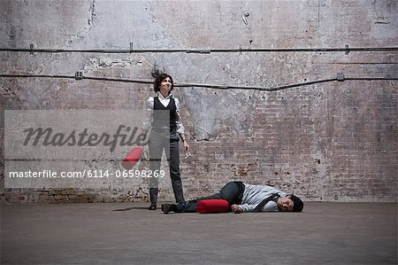 People fighting in warehouse Stock Photo - Premium Royalty-Free, Image code: 6114-06598269
