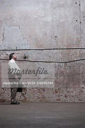 Man standing in warehouse Stock Photo - Premium Royalty-Free, Image code: 6114-06598284