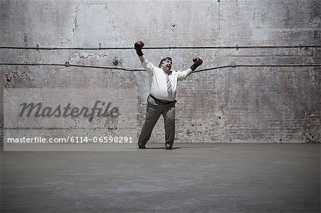 Man standing in warehouse Stock Photo - Premium Royalty-Free, Image code: 6114-06598291