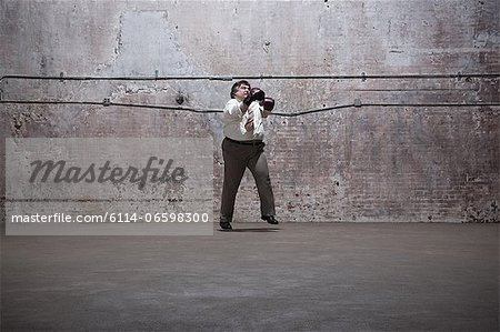 Man standing in warehouse Stock Photo - Premium Royalty-Free, Image code: 6114-06598300