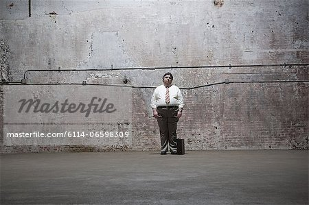 Man standing in warehouse Stock Photo - Premium Royalty-Free, Image code: 6114-06598309