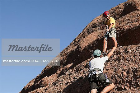 Two men rock climbing Stock Photo - Premium Royalty-Free, Image code: 6114-06598706