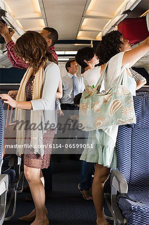 Passengers boarding a plane Stock Photo - Premium Royalty-Free, Image code: 6114-06599051