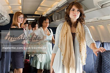 Passengers boarding a plane Stock Photo - Premium Royalty-Free, Image code: 6114-06599059
