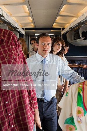 Passengers boarding a plane Stock Photo - Premium Royalty-Free, Image code: 6114-06599084