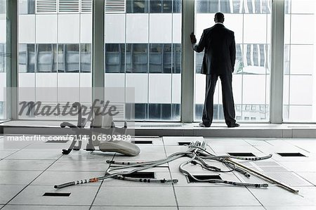 Businessman in abandoned office Stock Photo - Premium Royalty-Free, Image code: 6114-06599389