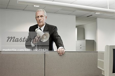 Businessman with megaphone Stock Photo - Premium Royalty-Free, Image code: 6114-06599434