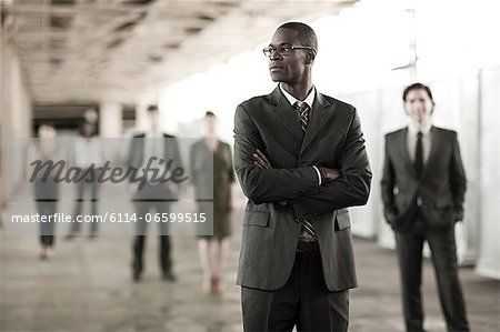 Businessman in focus Stock Photo - Premium Royalty-Free, Image code: 6114-06599515