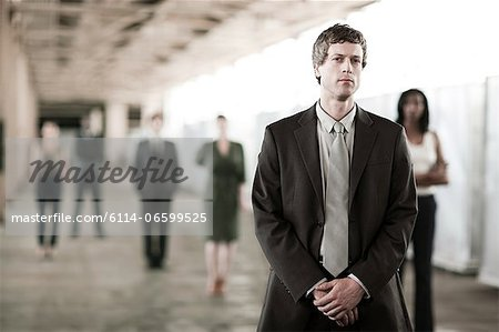 Businessman in focus Stock Photo - Premium Royalty-Free, Image code: 6114-06599525