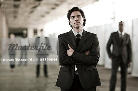 Businessman in focus Stock Photo - Premium Royalty-Free, Image code: 6114-06599546