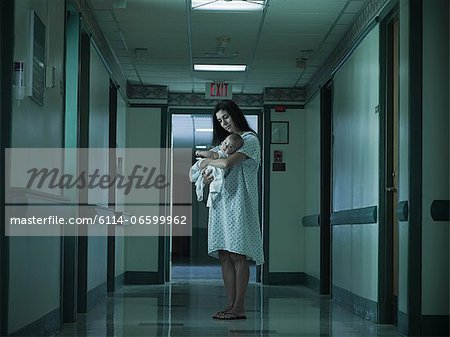 Mother with nerwborn baby in hospital Stock Photo - Premium Royalty-Free, Image code: 6114-06599962