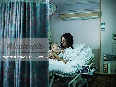 Mother with nerwborn baby in hospital Stock Photo - Premium Royalty-Free, Image code: 6114-06599995