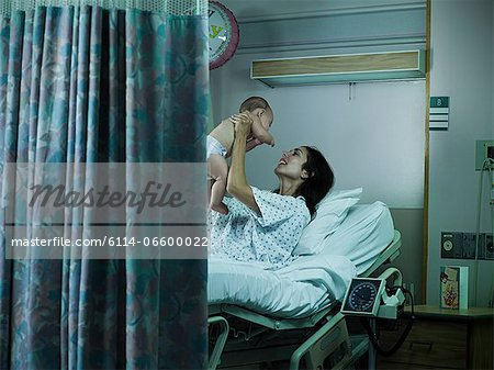 Mother with nerwborn baby in hospital Stock Photo - Premium Royalty-Free, Image code: 6114-06600022