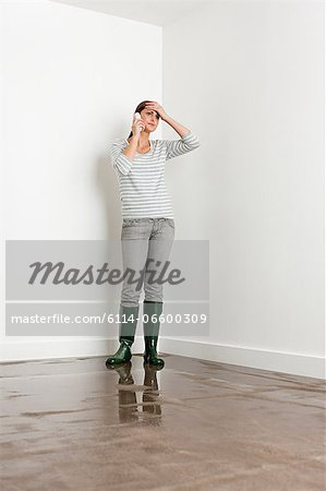 Young woman on flooded floor Stock Photo - Premium Royalty-Free, Image code: 6114-06600309
