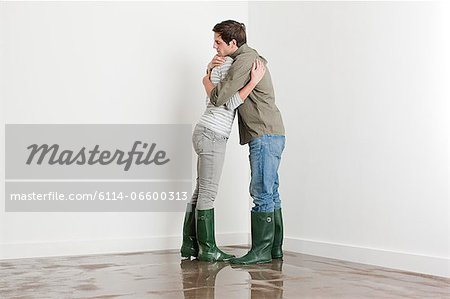 Young couple on flooded floor Stock Photo - Premium Royalty-Free, Image code: 6114-06600313