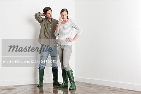 Young couple on flooded floor Stock Photo - Premium Royalty-Free, Image code: 6114-06600314