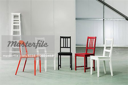 Five chairs in a warehouse Stock Photo - Premium Royalty-Free, Image code: 6114-06600458