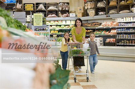 Mother and children in supermarket Stock Photo - Premium Royalty-Free, Image code: 6114-06600687