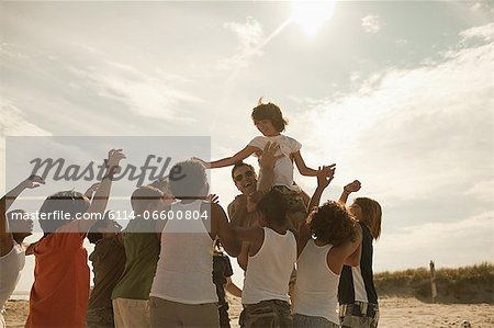 Boy being carried on shoulders Stock Photo - Premium Royalty-Free, Image code: 6114-06600804