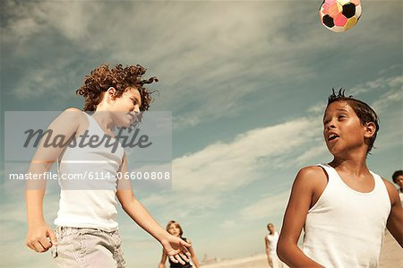 Boys heading football Stock Photo - Premium Royalty-Free, Image code: 6114-06600808