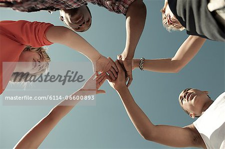 Boys doing huddle, low angle view Stock Photo - Premium Royalty-Free, Image code: 6114-06600893