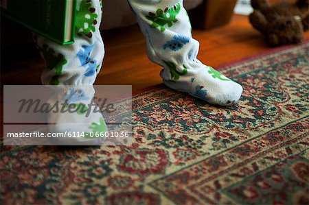Baby boy standing on rug Stock Photo - Premium Royalty-Free, Image code: 6114-06601036