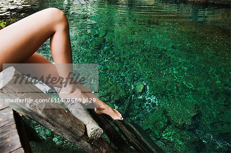 Young woman on wooden ladder, Grande Cenote, Quintana Roo, Tulum, Mexico Stock Photo - Premium Royalty-Free, Image code: 6114-06601629
